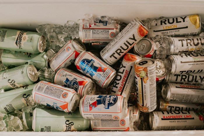 assorted cans and cans on white table